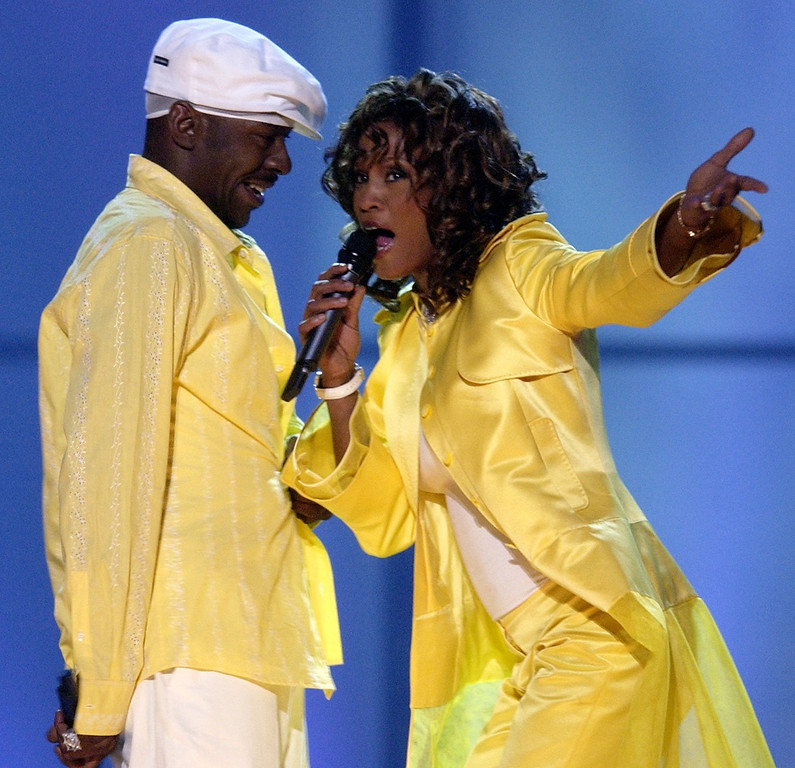 """. Whitney Houston, right, and her husband, Bobby Brown, perform during the \""""VH1 Divas\"""" duets show Thursday, May 22, 2003, in Las Vegas. (AP Photo/Joe Cavaretta)"""