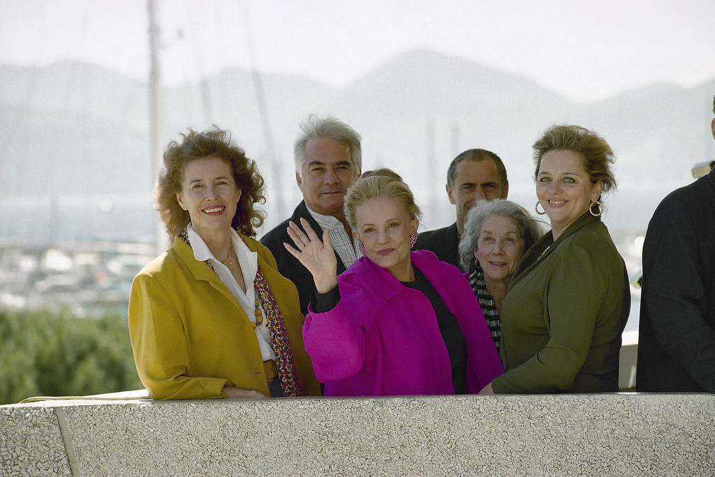 . Members of the jury of the Cannes Films Festival pose for photographers on the first day of the festival on Wednesday, May 17, 1995. From left: French producer Michele Ray-Gavras, French actor Jean-Claude-Brialy, jury president Jeanne Moreau of France waving, French director of photography Philippe Rousselot, South African novelist Nadine Gordimer and Russian script writer Maria Zvereva right. (AP Photo/Remy de la Mauviniere)