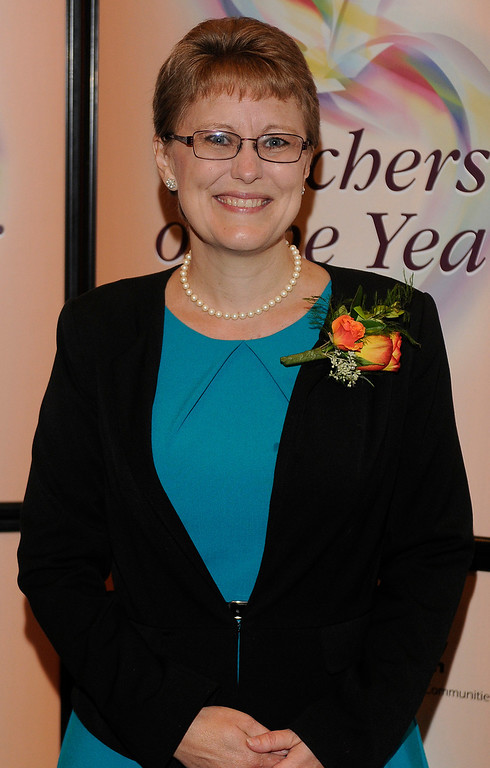 . Julie McGough from Azusa USD. Sixteen teachers from throughout the Los Angeles County were named as Teachers of the Year during a ceremony at the Universal Hilton. Teachers received a cash award from the California Credit Union as well as software and hardware to use in their classrooms from eInstruction. Universal City, CA. 9/27/2013. photo by (John McCoy/Los Angeles Daily News)