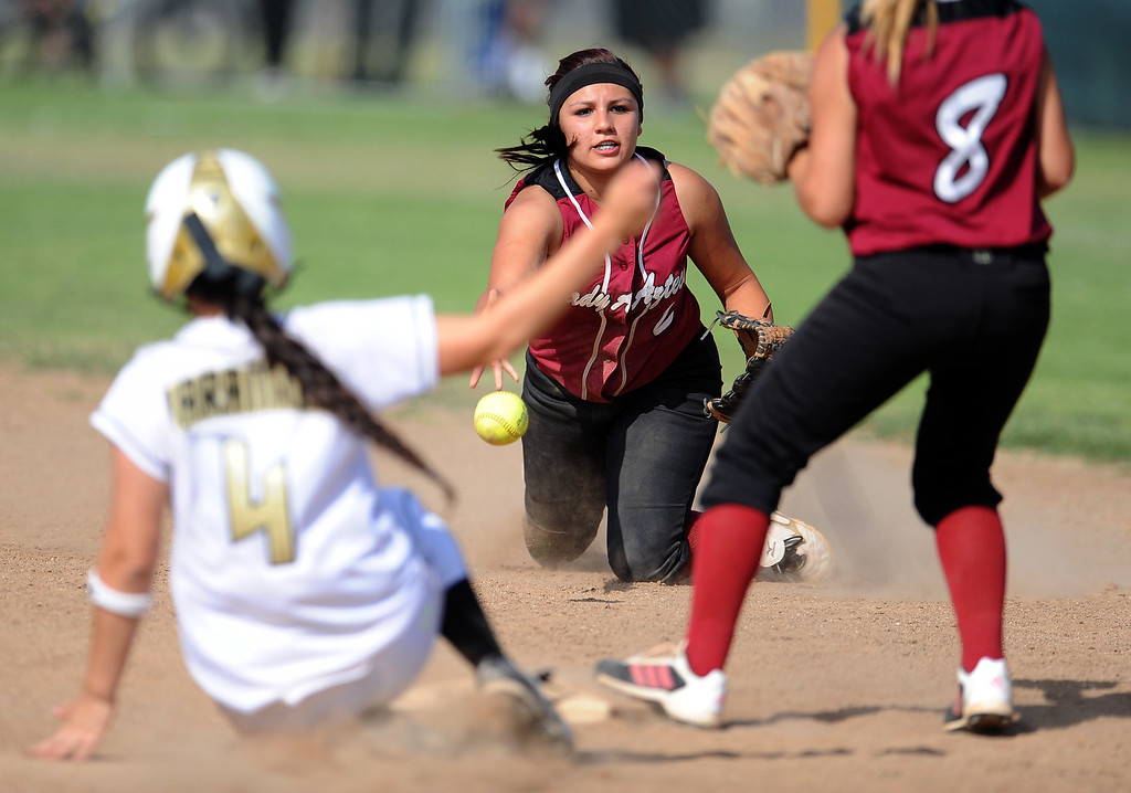 . Barstow shortstop Aleesha Rodriguez flips late as Northview\'s Erinn Jaramillo (C) (4) is safe at second base as Barstow second baseman Meagan Alvarez (C) (8) waits for the softball in the sixth inning of a CIF-SS quarterfinal playoff softball game at Northview High School on Thursday, May 23, 2013 in Covina, Calif. Northview won 5-4.  (Keith Birmingham Pasadena Star-News)