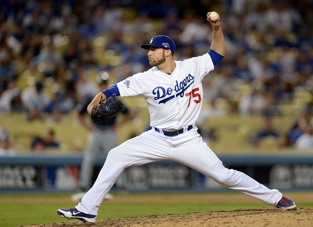 . Los Angeles Dodgers\' Paco Rodriguez pitches to the Braves during game 3 of the NLDS at Dodger Stadium Sunday, October 6, 2013. (Photo by Hans Gutknecht/Los Angeles Daily News)