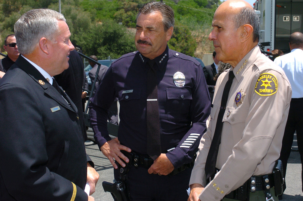 . (l-r) Freeman, Beck and Baca talk before the press conference. Mayor Antonio Villaraigosa, Los Angeles City Fire Department Chief Millage Peaks, Los Angeles County Fire Department Chief P. Michael Freeman, LAPD Chief Charlie Beck and Sheriff Lee Baca held a news conference to discuss the high fire danger and potential for injury associated with fireworks and the dangers associated with discharging firearms into the air on the Fourth of July. Los Angeles, CA 07/01/2010 (John McCoy/Staff Photographer)