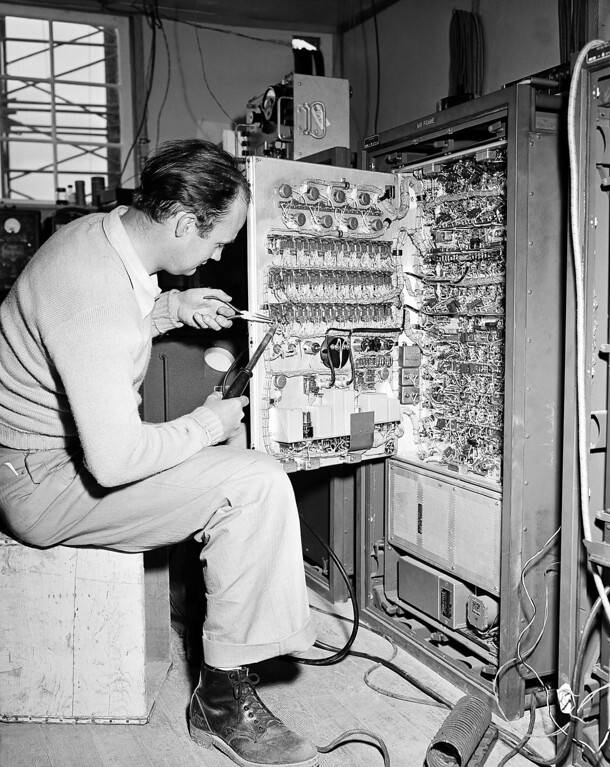 . J.J. Debuske, from the New York Bell Telephone Laboratory technical staff, is shown making a repair on the equipment in Catalina Island, Calif. This shows a multiplex frame inside the small building, about three miles from Avalon, Calif. This frame is the nerve center of the new micro-wave radio and telephone system between Catalina Island and Los Angeles. (AP Photo)