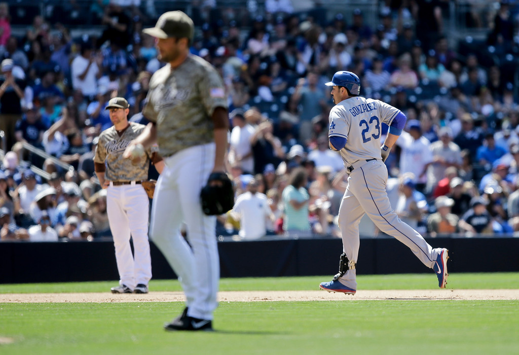 . Los Angeles Dodgers\' Adrian Gonzalez (23) rounds the bases with his ninth-inning home run as San Diego Padres closer Huston Street gather himself in a baseball game won by the Dodgers 3-1 in San Diego, Sunday, June 23, 2013. (AP Photo/Lenny Ignelzi)