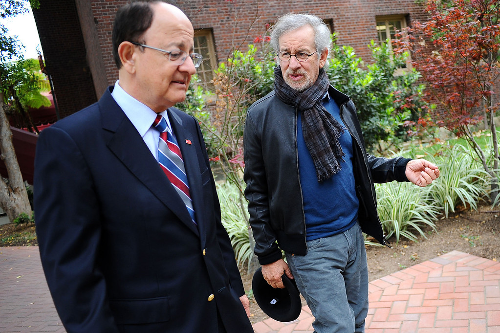 . Steven Spielberg and USC President C. L. Max Nikias make their way across campus Friday, April 25, 2014.  They were on hand to  announce that USC will establish the Center for Advanced Genocide Research which will serve as the research and scholarship unit of the Shoah Foundation. (Andy Holzman/Los Angeles Daily News)