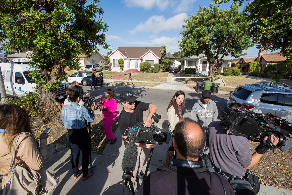 """. Neighbors are interviewed by media in front of the home of actor Michael Jace on Tuesday, May 20, 2014, in Los Angeles.  Jace, who played a police officer on the hit TV show \""""The Shield,\"""" was arrested on suspicion of homicide after his wife was found shot to death in their Los Angeles home, authorities said. Police arrived at the couple\'s home around 8:30 p.m. Monday after a report of shots fired, Officer Chris No said. April Jace, 40, was found dead inside, officials said.  Jace was taken into custody and booked early Tuesday on suspicion of homicide, No said. He was being held in a Los Angeles jail in lieu of $1 million bail.   (AP Photo/Ringo H.W. Chiu)"""