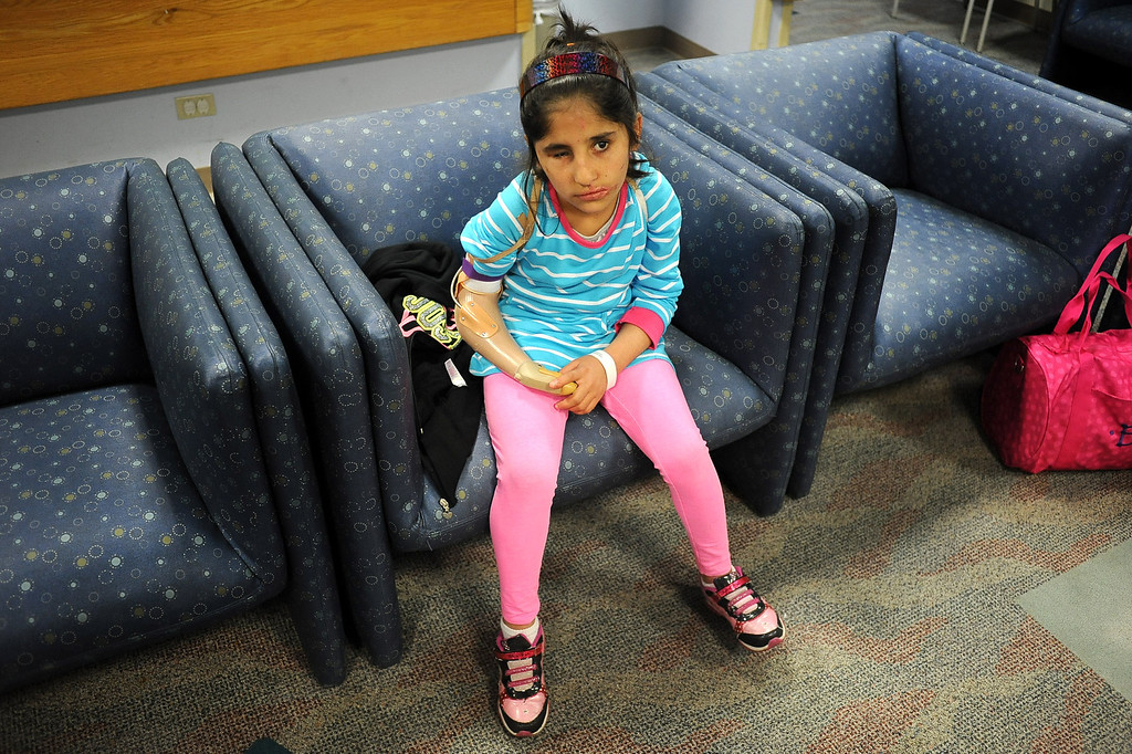 . Shah Bibi, 7, of Afghanistan waits for her occupational therapy appointment at Shriners Hospital for Children in Los Angeles, CA April 2, 2014.  Bibi lost most of her right arm and the use of an eye after picking up a hand grenade.  She was brought to Southern California for medical treatment in December by the Children of War Foundation and is set to return to her remote Afghani village next week.(Andy Holzman/Los Angeles Daily News)