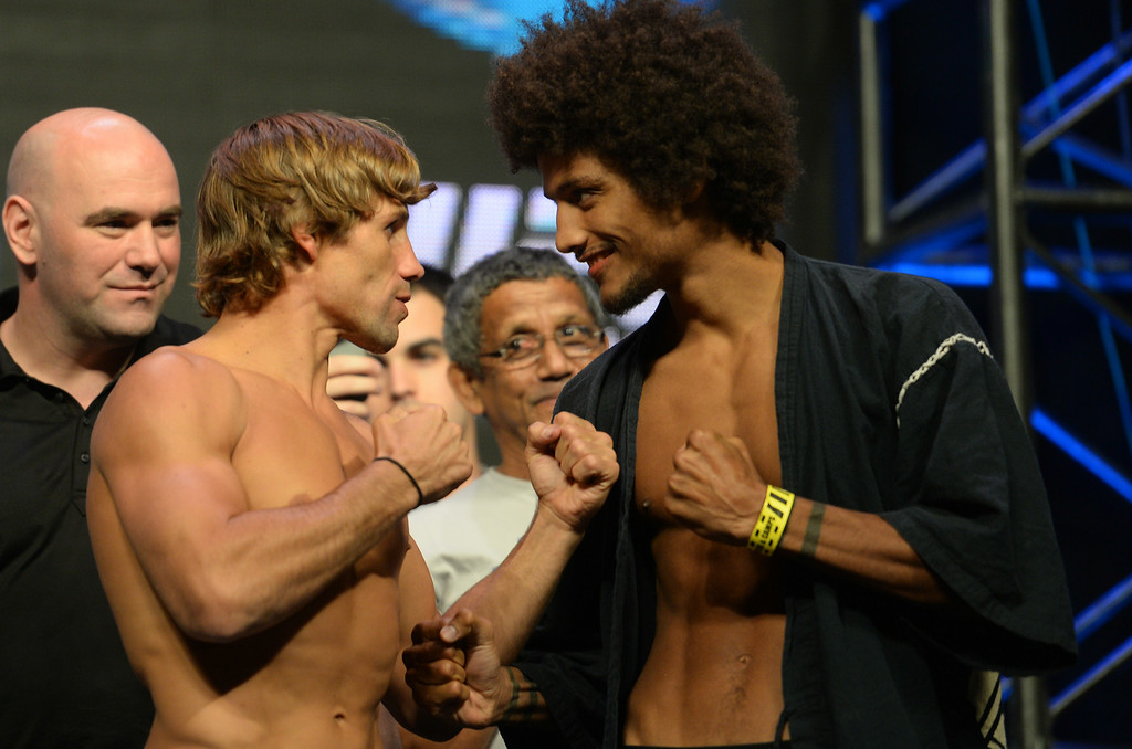 . Urijah Faber and Alex Caceres during weigh ins for UFC 175 at the Mandalay Bay Events Center July 4, 2014. (Photo by Hans Gutknecht/Los Angeles Daily News)