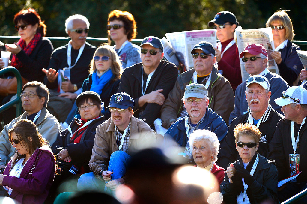. Golf enthusisats await the first golfers during the first-round of Tiger Woods\' Northwestern Mutual World Challenge at Sherwood Country Club in Thousand Oaks, CA Thursday December 5, 2013.  Frist-round play was delayed an hour due to icy conditions on the course.(Andy Holzman/Los Angeles Daily News)