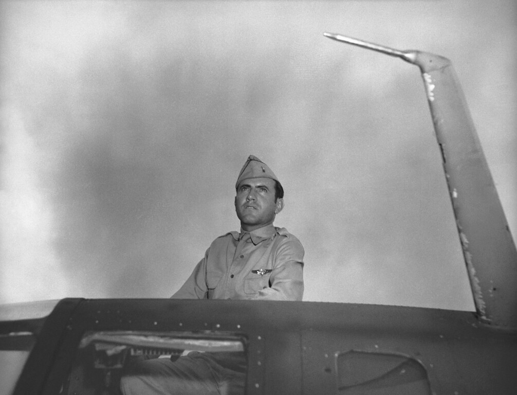 . Louis Zamperini, former USC athletic star now a bombardier in the Army Airforce, peers out of hatch nose of bomber on Jan. 1, 1943. Zamperini was bombardier of one of the planes in recent raid on Wake Island. (AP Photo/Jack Rice)