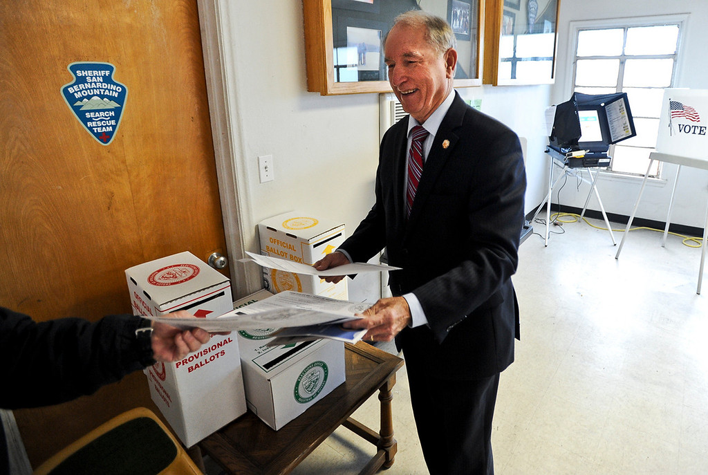 . San Bernardino Mayor Patrick Morris hands off his ballot after voting in the city\'s general and special municipal election at the San Bernardino Mountain Search and Rescue polling location on Tuesday, Feb. 4, 2014. (Photo by Rachel Luna / San Bernardino Sun)
