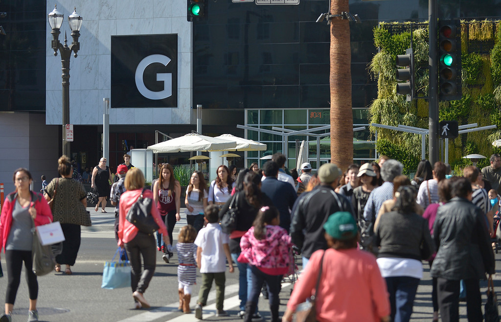 . People cross Central Avenue to enter the Glendale Galleria. The mall has completed a major renovation and is celebrating this weekend with a grand re-opening. Glendale, CA. 11/8/2013. photo by (John McCoy/Los Angeles Daily News)
