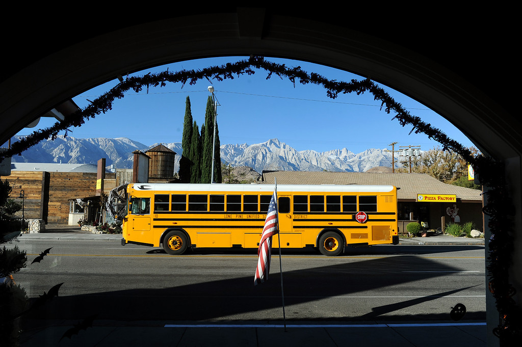 . A school bus drives along Highway 395 through the town of Lone Pine. (Photo by Michael Owen Baker/L.A. Daily News)