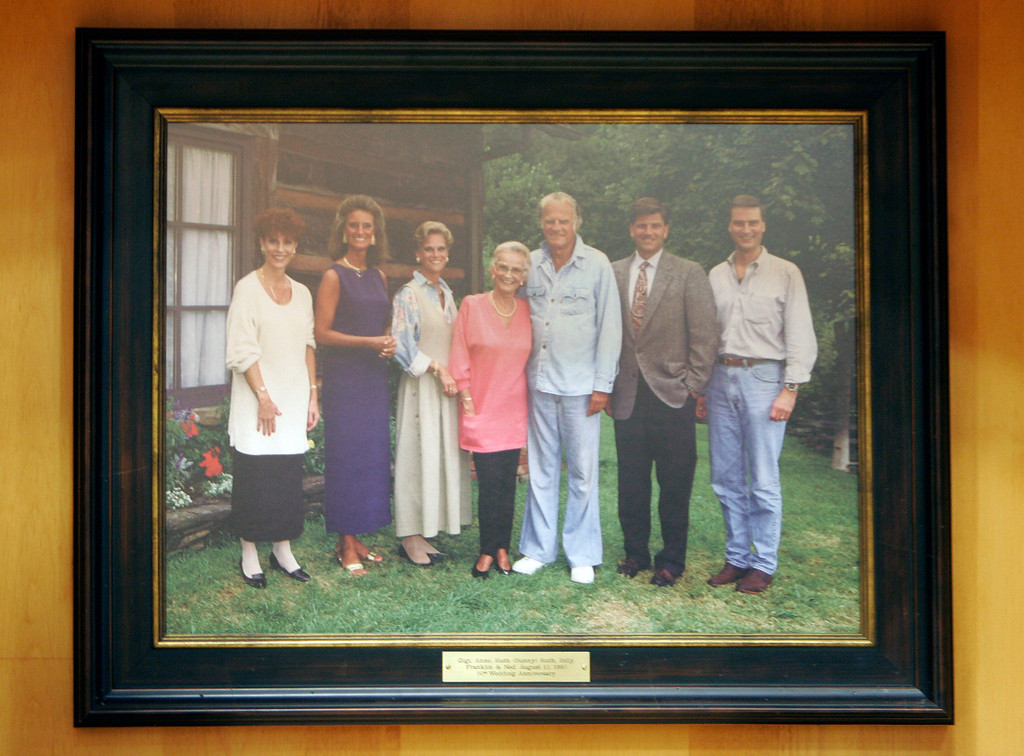""". This 1993 family photo showing, from left, Gigi Graham Tchividjian, Anne Graham Lotz, Ruth \""""Bunny\"""" Graham, Ruth Graham, Billy Graham, Franklin Graham, and Ned Graham hangs on display at the Billy Graham Library in Charlotte, N.C., Tuesday, May 29, 2007. (AP Photo/Chuck Burton)"""