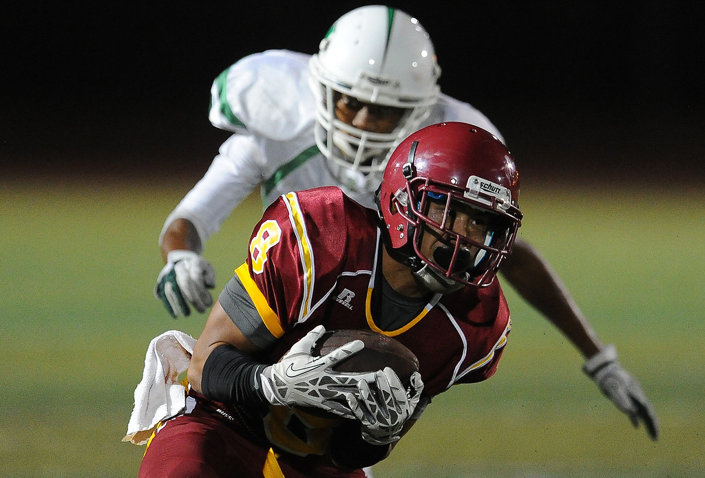 . Arcadia\'s Nico Canto (8) catches a pass and runs for a touchdown against Monrovia in the first half of a prep football game at Arcadia High School in Arcadia, Calif. on Friday, Sept. 13, 2013.   (Photo by Keith Birmingham/Pasadena Star-News)
