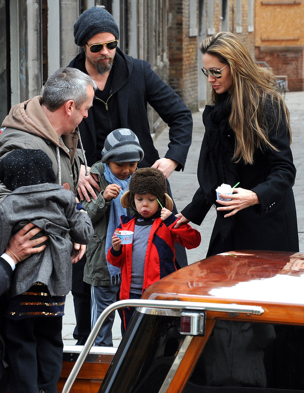 ". Actors Angelina Jolie, right, and Brad Pitt, second left,are seen with children Maddox, left, Shiloh Nouvel, in Venice, Tuesday, Feb. 16, 2010. Angelina Jolie is in Venice to shoot scenes of the movie ""The Tourist\"", by director Florian Henckel von Donnersmarck. (AP Photo/Luigi Costantini)"