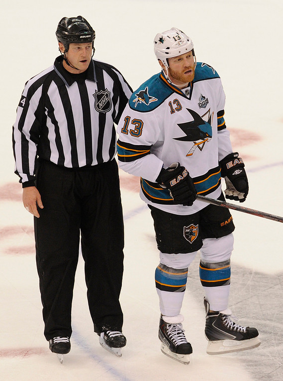 . Sharks #13 Raffi Torres is escorted to the penalty box in the 2nd period. The Kings played the San Jose Sharks during the first game in the Second Round of the Western Conference Playoffs. Los Angeles CA 5/14/2013(John McCoy/LA Daily News)