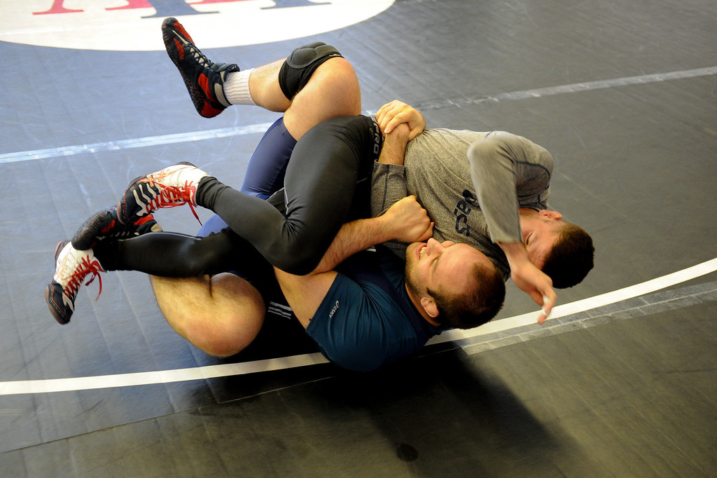 . The U.S. national wrestling team members Tervel Dlagnev, left, and Jon Reader practice at Harvard-Westlake High School, Friday, May 17, 2013.