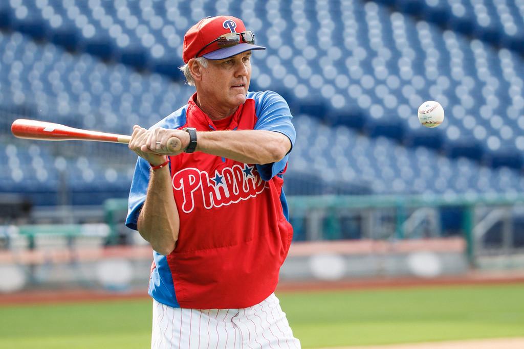 . Philadelphia Phillies interim manager Ryne Sandberg hits the ball for fielding drills before a baseball game against the Los Angeles Dodgers, Friday, Aug. 16, 2013, in Philadelphia. (AP Photos/Christopher Szagola)