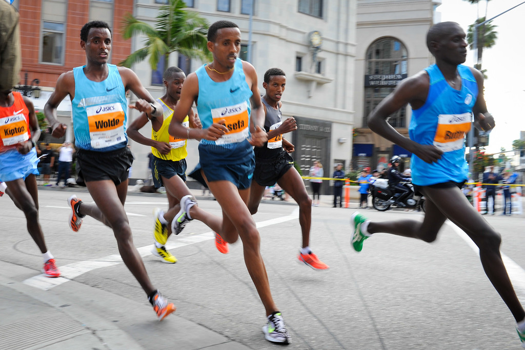 . Men\'s elite runners with men\'s winner Gebo Burka, second from right, round a corner onto Wilshire Boulevard at mile 17 in Beverly Hills in the Los Angeles Marathon, Sunday, March 9, 2014. (Photo by Michael Owen Baker/L.A. Daily News)