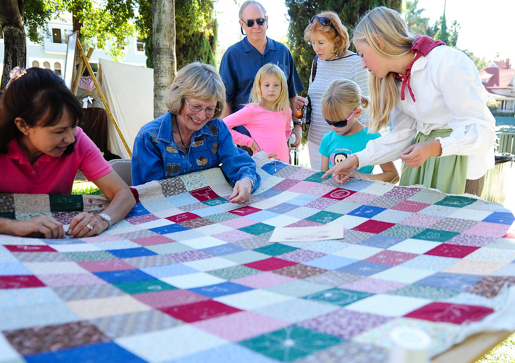 . Redlands community participates in creating a quilt at the Redlands 125th anniversary celebration on Saturday, Nov. 2, 2013. (Photo by Rachel Luna / San Bernardino Sun
