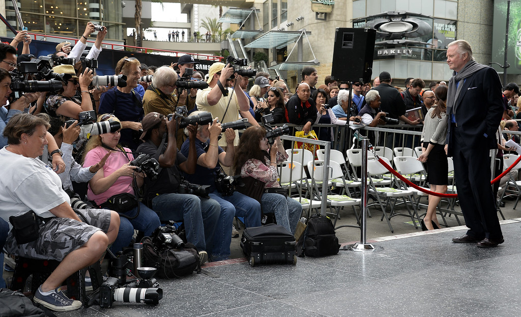 . Photographers take pictures of US actor Jon Voight (R) prior to a ceremony honoring US producer Jerry Bruckheimer with a star on the Hollywood Walk of Fame in Hollywood, California, USA, 24 June 2013. Bruckheimer received the 2,501st star on the Hollywood Walk of Fame.  EPA/MICHAEL NELSON
