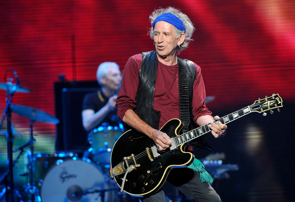 ". Keith Richards of the Rolling Stones performs on the kick-off of the band\'s ""50 and Counting\"" tour at the Staples Center on Friday, May 3, 2013 in Los Angeles. (Photo by Chris Pizzello/Invision/AP)"