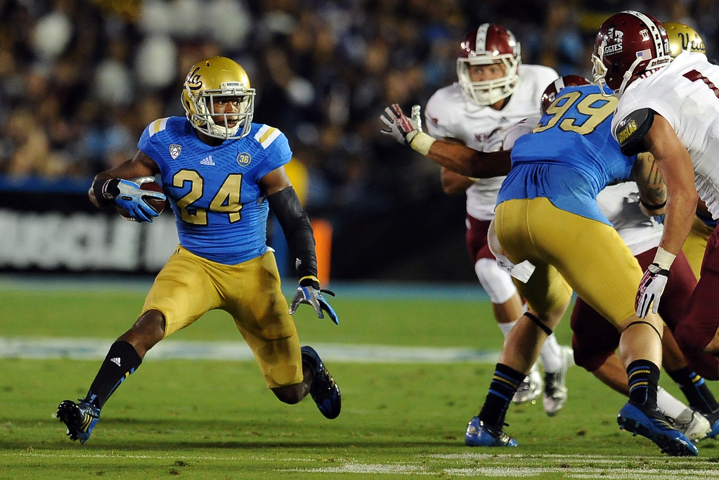 . UCLA running back Paul Perkins (24) runs for a first down against New Mexico State during the first half of their college football game in the Rose Bowl in Pasadena, Calif., on Saturday, Sept. 21, 2013.   (Keith Birmingham Pasadena Star-News)