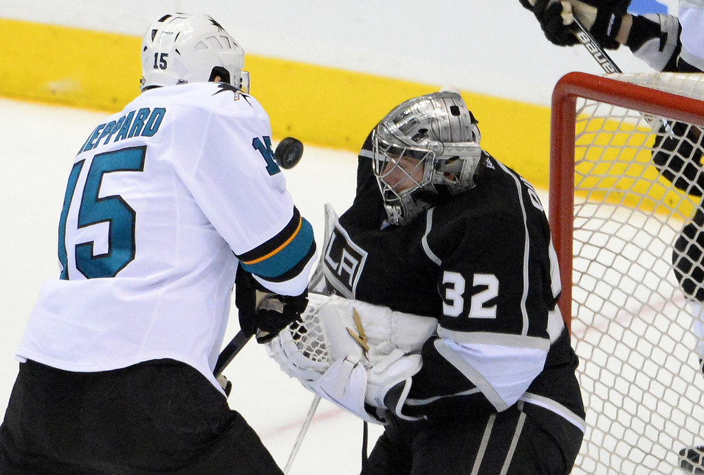 . San Jose Sharks left wing James Sheppard (15) scores past Los Angeles Kings goalie Jonathan Quick (32) during the first period in Game 4 of an NHL hockey first-round playoff series at Staples Center in Los Angeles on Thursday, April, 24  2014.  (Keith Birmingham Pasadena Star-News)
