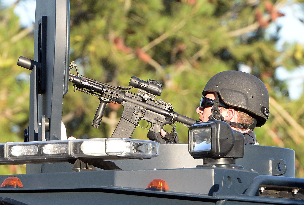 . Ontario police and SWAT members search for a murder suspect in the Camden Land Mark Apartments in Ontario Thursday June 12, 2014 after a man was found shot to death on the apartments property. (Will Lester/Inland Valley Daily Bulletin)