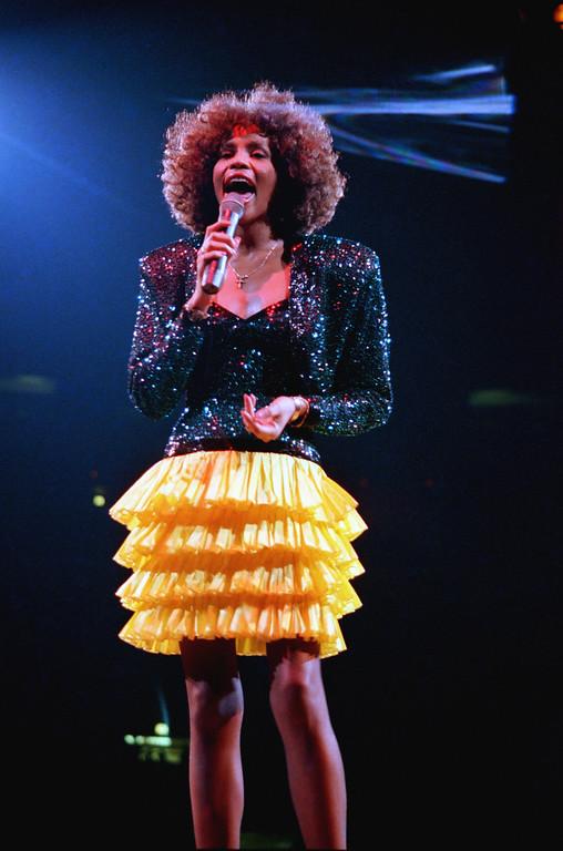 . Singer Whitney Houston performs at New York\'s Madison Square Garden, Tuesday, Sept. 8, 1987.  (AP Photo/Mario Suriani)