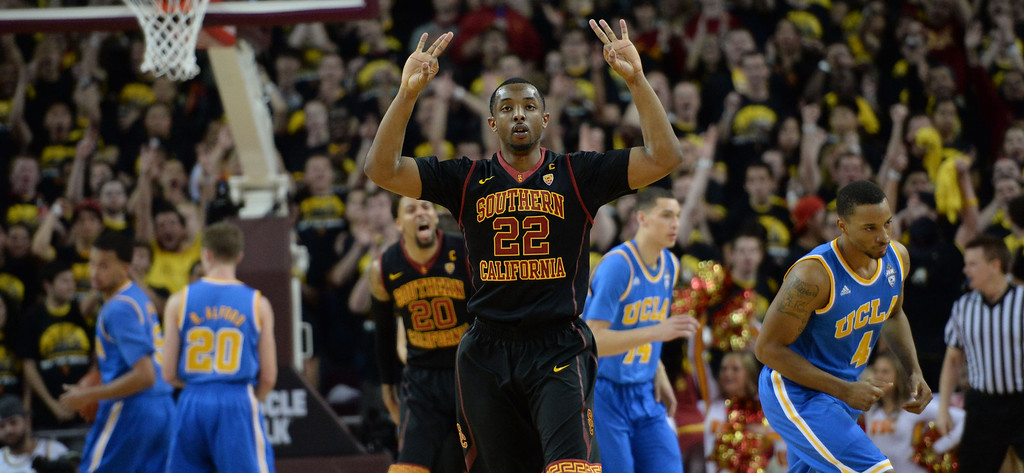 . Southern California\'s Byron Wesley (22) holds-up three fingers after hitting a three pointer against UCLA n the first half of a PAC-12 NCAA basketball game at Galen Center in Los Angeles, Calif., on Saturday, Feb. 8, 2014. (Keith Birmingham Pasadena Star-News)