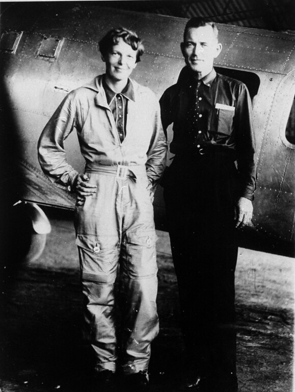 . In a 1937 file photo aviator Amelia Earhart and her navigator, Fred Noonan, pose in front of their twin-engine Lockheed Electra in Los Angeles prior to their historic flight in which Earhart was attempting to become first female pilot to circle the globe.   (AP Photo, File)