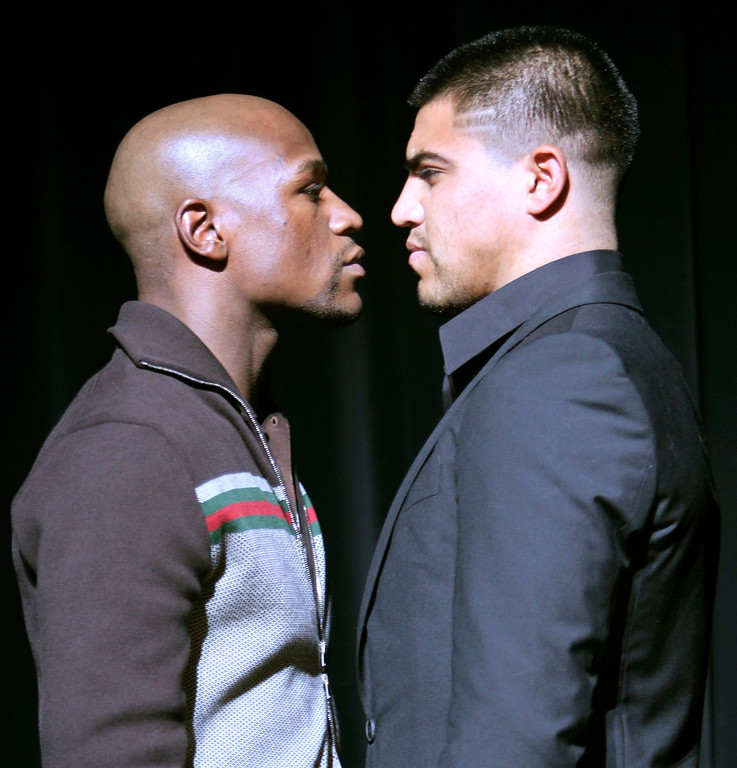 . Boxers Floyd Mayweather Jr., left, and Victor Ortiz face off during a news conference, Tuesday, June 28, 2011 in New York. Ortiz is scheduled to defend his WBC welterweight title against Mayweather on Sept. 17 in Las Vegas.  (AP Photo/Mary Altaffer)