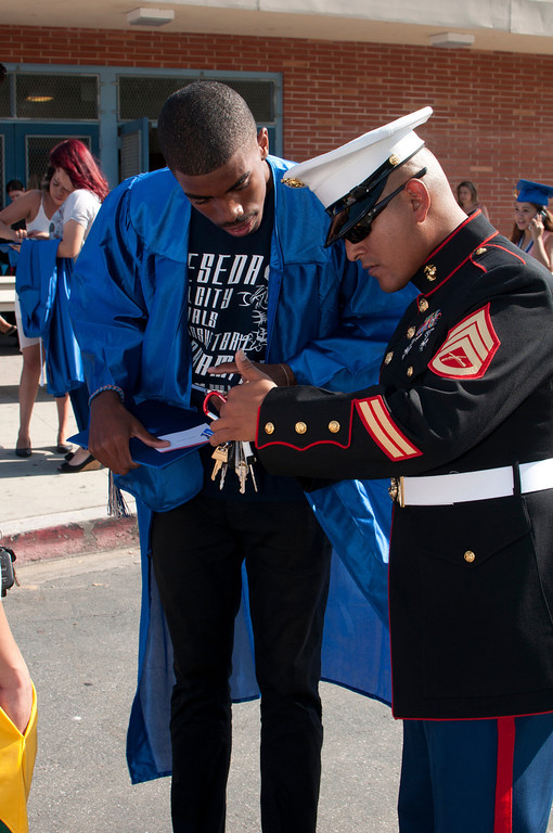 . Senior Cedric Galloay speaks with Staff Sgt. Guerrero, about the Marin e Core out side Resada\'s High School gym. The Reseda High School graduation class held their commencement in the school football field on Friday,  June 07, 2013 in Reseda, CA.   Photo by Carlos Carpio