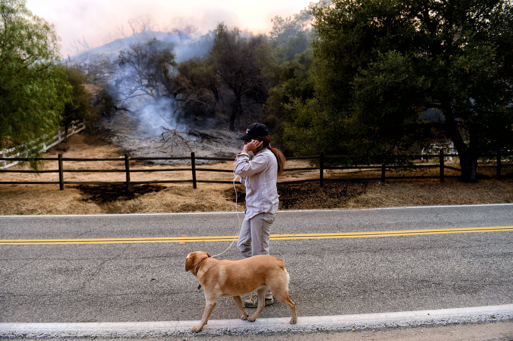 . A resident walks along Hidden Valley Rd as the Springs Fire comes close to home in Thousand Oaks Friday, May 3, 2013. (Hans Gutknecht/LA Daily News)