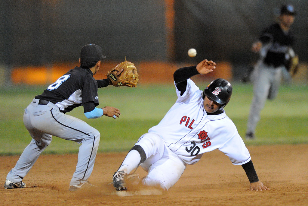 . WILMINGTON - 05/02/2013  (Photo: Scott Varley, Los Angeles Newspaper Group)  Carson vs Banning baseball at Banning High. Banning\'s Mario Verduzco slides safe at second with a double as Eric Bahena waits for the throw from right fielder Joseph Cortez.