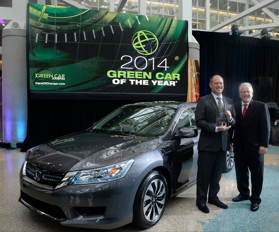 ". Nov 22,2013 Los Angeles CA. (L-R) Senior VP of automotive operations of Honda America Mike Accavitti holds the award presented by Ron Gogan editor and publisher of Green Car Journal, as Honda accord  was named ""2014 green car of the year\""  on displays during the 2nd media day at the Los Angeles Auto Show. The show opens to the public today Friday and runs through Dec 1st.  Photo by Gene Blevins/LA Daily News"