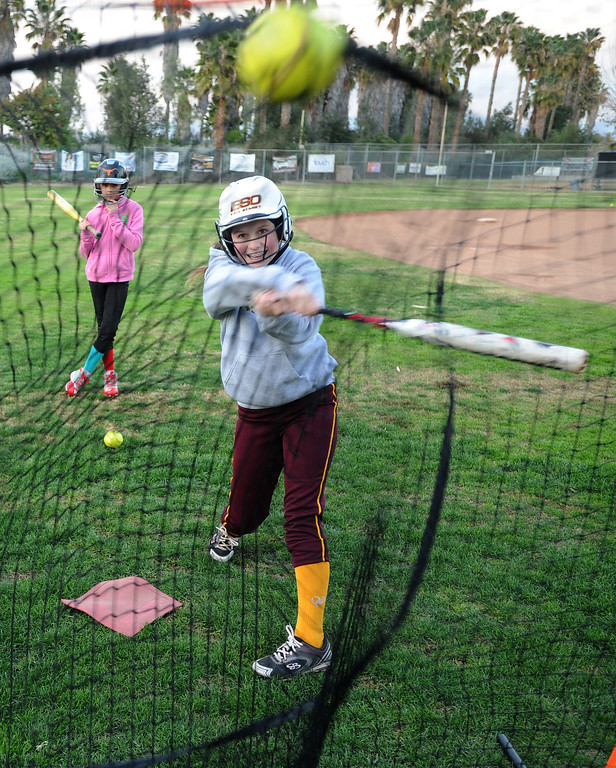 . Carson Durham,12, takes a swing during batting practice. A dispute has erupted between the nonprofit Encino-Sherman Oaks Softball � a four-year-old, award-winning fast-pitch league serving girls--and Mid-Valley Boys Baseball, which operates at the same complex at 17301  Oxnard St. Encino CA. February 5, 2014 (Photo by John McCoy / Los Angeles Daily News)