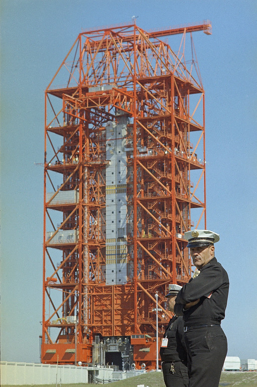 . Unidentified guard stands at the Saturn 1 launch pad area on January 28,1967 at the Cape Kennedy Space Center the day after a flash fire that caused the deaths the Apollo 1 crew at Cape Canaverel, Fla.  Three astronauts, Lt. Col. Virgil Grissom; Lt. Col Edward H. White, and Lt. Commander Roger Chafee were killed January 27, 1967 when a fire erupted on the launch pad during a preflight test for the Apollo 1, AS-204 Moon mission.   (AP Photo)