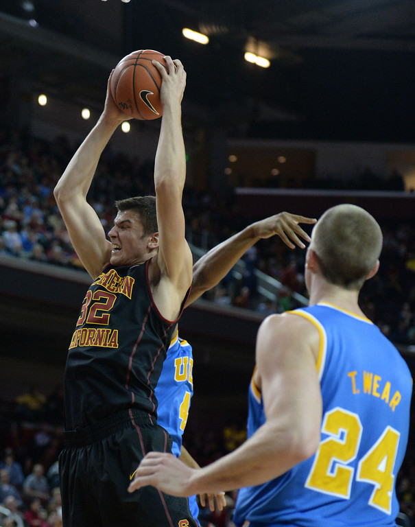 . Southern California\'s Nikola Jovanovic (32) rebounds against UCLA in the first half of a PAC-12 NCAA basketball game at Galen Center in Los Angeles, Calif., on Saturday, Feb. 8, 2014. (Keith Birmingham Pasadena Star-News)