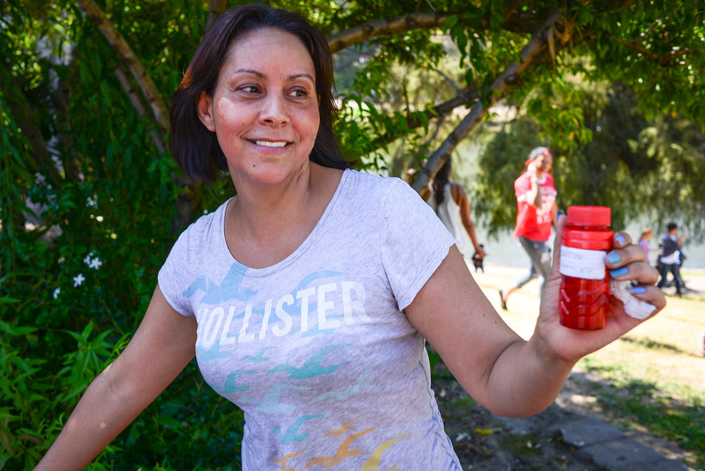 . Maria Mendoza of Chicago found a stash of hidden cash at Hollenbeck Park on June 1, 2014. The Hidden cash has been turning up for the last couple of days around Los Angeles.  According to the @hiddencash twitter the cash drop at Hollenbeck park was the last in Los Angeles.  ( Photo by David Crane/Los Angeles Daily News )