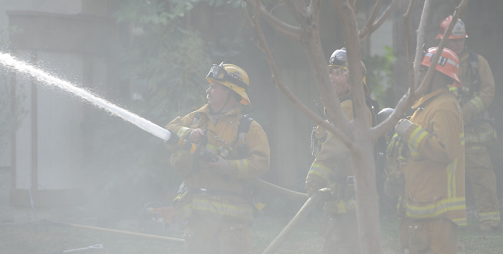 . Los Angeles County Firefighters battle a fire in smoke that damaged a single family home. The fire started in the garage along the 1300 block of Via Verde. No injuries, but 5 cars were destroyed including two jaguars in San Dimas, Calif., on Saturday, Jan.4, 2014.   (Keith Birmingham Pasadena Star-News)