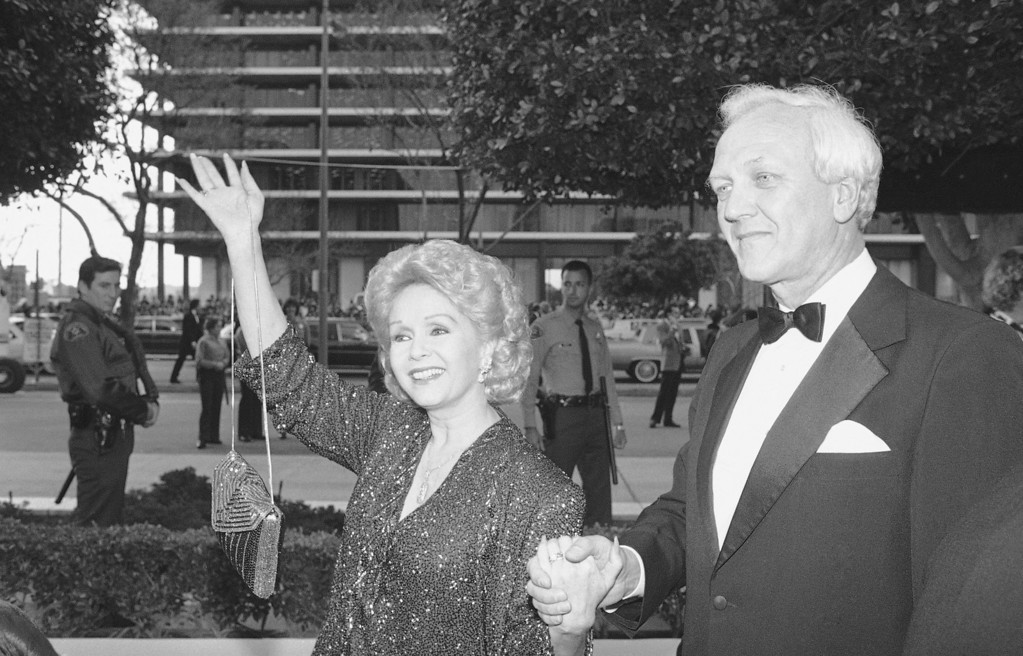 . Debbie Reynolds and her husband Richard Hamlett arrive for Oscar telecast, March 25, 1985. (AP Photo)