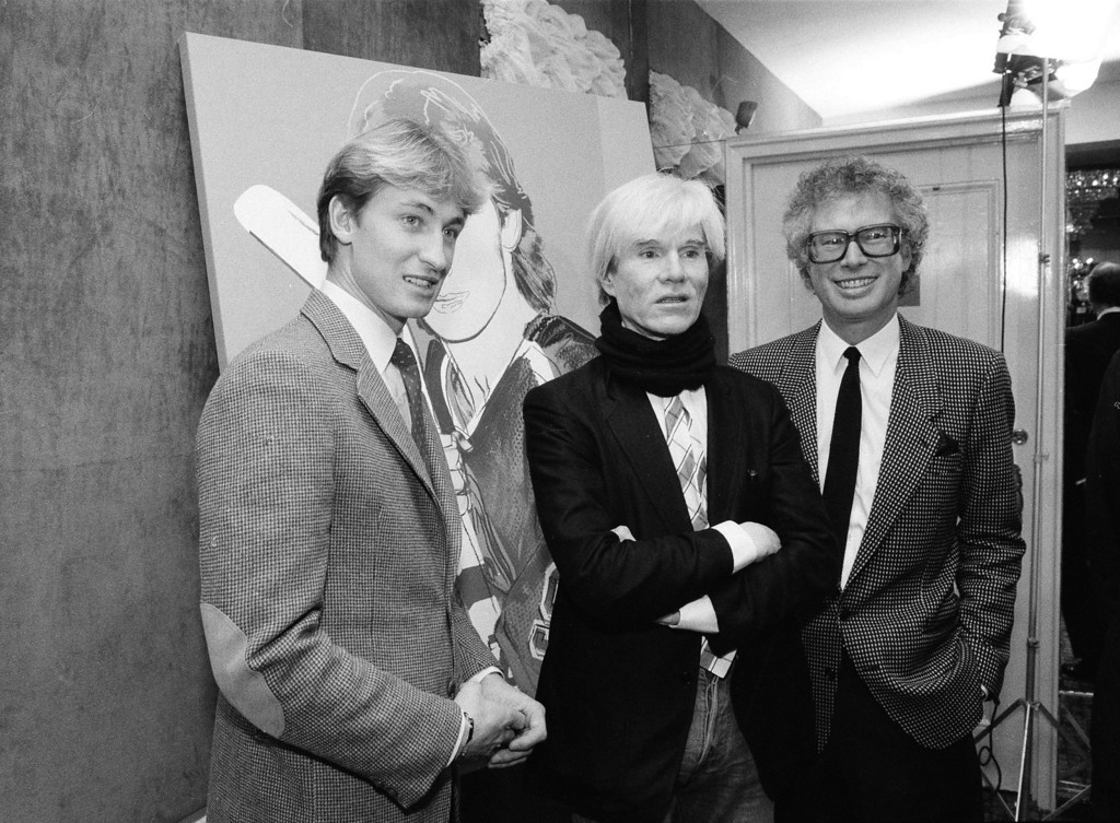. Edmonton Oilers center Wayne Gretzky, left, poses with Andy Warhol and Canadian Ambassador Ken Taylor, after Warhol unveiled his portrait of Gretzky at the St. Moritz Hotel in New York, Dec. 12, 1983. (AP Photo/Mario Suriani)