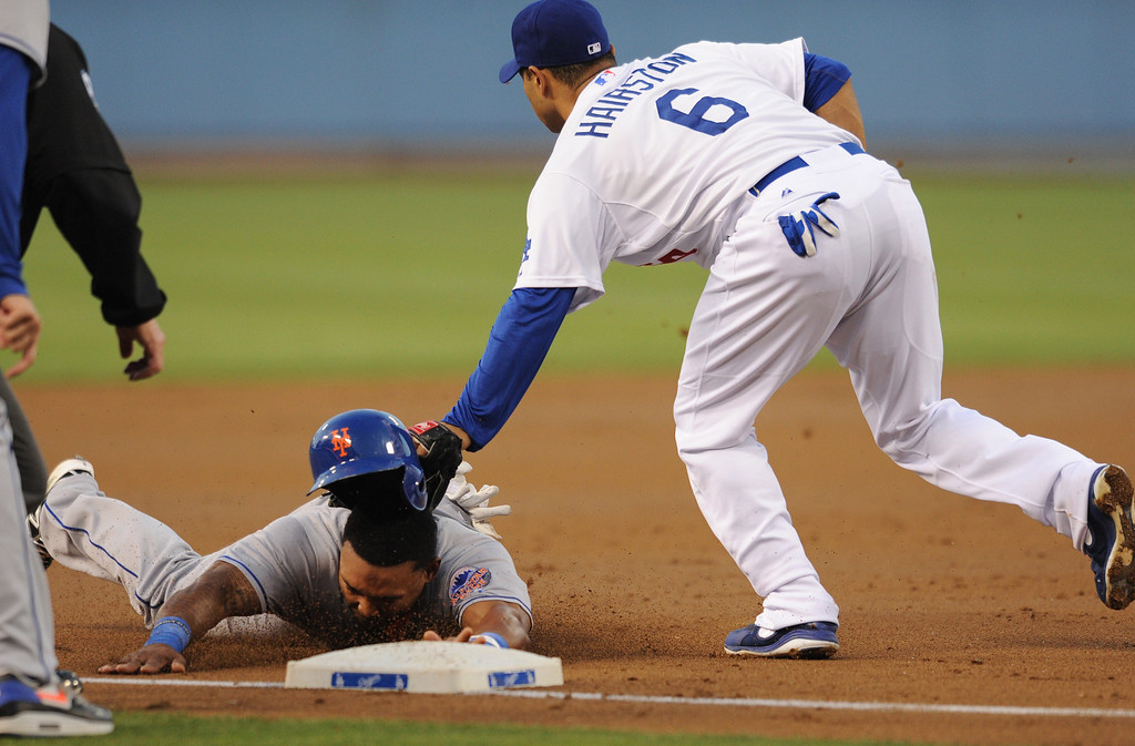 . Mets Marlon Byrd is tagged out at 3rd base by Dodgers Jerry Hairston Jr. when he tried to get an extra base on a single hit by Justin Turner in the 2nd inning. The Dodgers play the New York Mets in a game at Dodger Stadium in Los Angeles, CA. 8/13/2013(John McCoy/LA Daily News)