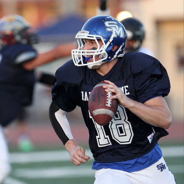 . San Marino\'s Andrew Ferraco (18) looks to pass during the 35th Annual Hall of Fame All-Star Football Game at West Covina High School in West Covina, CA on Friday, May 16, 2014. (SVGN/Correspondent Photo by David Thomas/SPORTS)