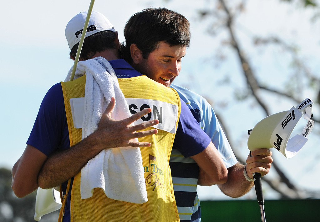 . Bubba Watson gets a hug from his caddy Ted Scott moments after Watson made a birdie put on 18 to finish 14 under for the tournament. Watson won the 2014 Northern Trust Open. Pacific Palisades, CA. February 16, 2014 (Photo by John McCoy / Los Angeles Daily News)