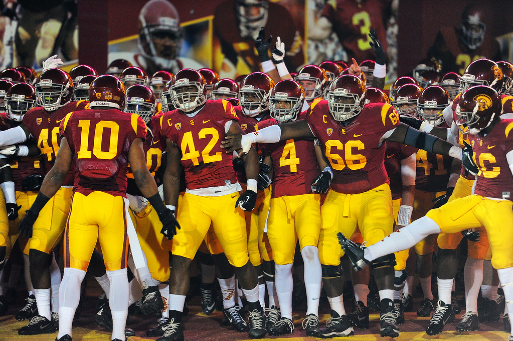 . USC players prepare to take the field in the first half during their game against Arizona at the Los Angeles Memorial Coliseum Thursday, October 10, 2013. (Photo by Hans Gutknecht/Los Angeles Daily News)