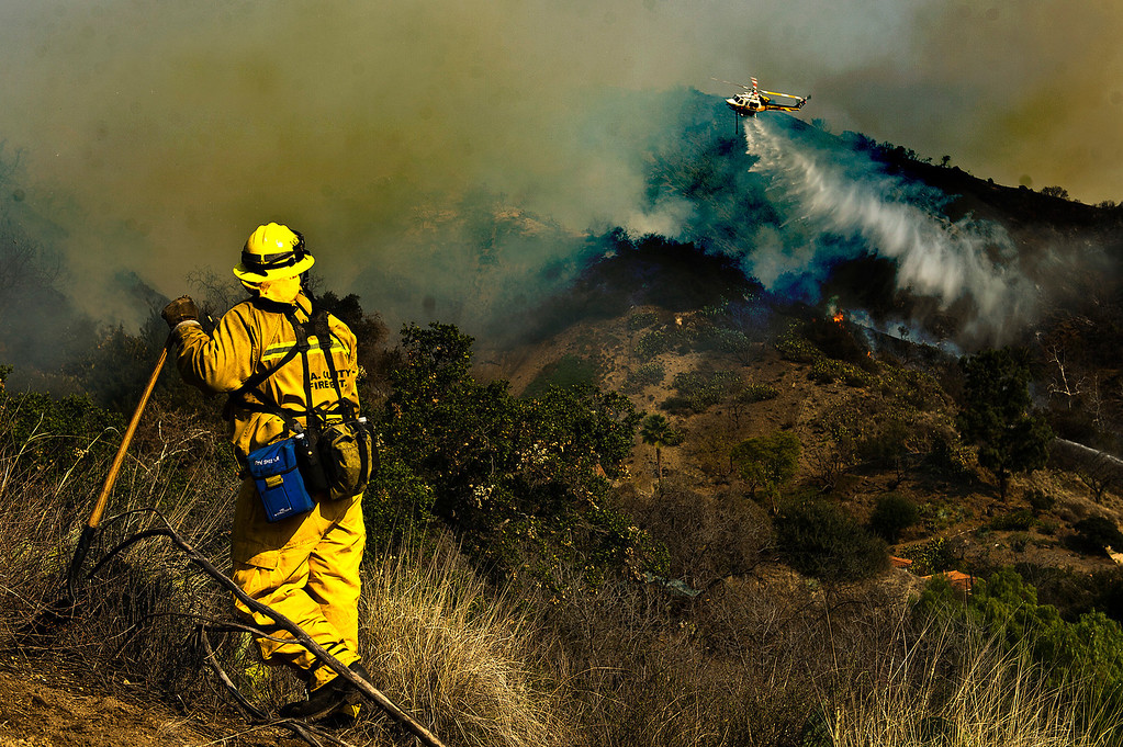 . Firefighters battle the Colby Fire next to a home on Hicrest Road in Glendora, Calif. on Thursday, Jan. 16, 2014. (Photo by Watchara Phomicinda/ San Gabriel Valley Tribune)